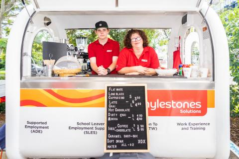 Lachlan and Adelaide standing inside the Mylestones Solutions Coffee Cart